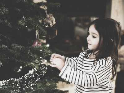 girl at christmas tree