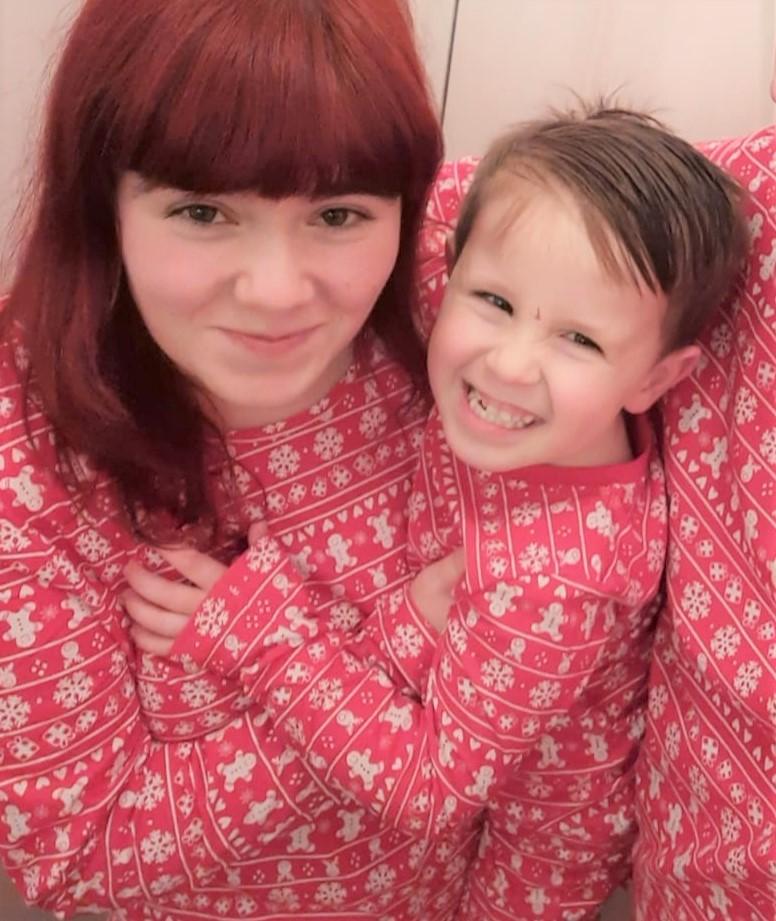 Shannon and AJ enjoy a cuddle in cosy pyjamas